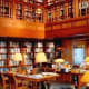 """The hallmark of a really big house is the huge library inside it, and Gates made sure to include a 2,100 square foot one, complete with a domed roof. And in yet another example of a """"thing that would be put in a movie to show you how rich the character is,"""" the library features two secret pivoting bookcases - one of which even turns into a bar.That's not even close to being the most impressive part of the library, though. No, that honor goes to theCodex Leicester, a 16th century notebook that belonged to none other than Leonardo da Vinci. Gates picked up this impressive relic at a 1994 auction and had to pay $30.8 million to get it."""