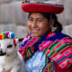 Peru: 16.7%Peru is rich in archeological sites, such as Machu Picchu. Visitorsoften go to see the Nazca Lines and the Amazon River, or visit Lima, the capital. Above, a Peruvian womanin Cusco wears traditional native clothing.Photo: Wollertz / Shutterstock