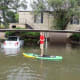 Flooding: Thewarming atmosphere holds more moisture, so the chance of extreme rainfall and flooding continues to rise in some regions with rain or snow. Above, a teenager rides a paddle board in the flooded streets of Houston in 2017.Photo: IrinaK / Shutterstock