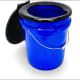 ...Portable Toilet BucketThis handy bucket with a seat holds five gallons, lightweight and easy to clean (if you use the bag liners that come with it.) $21.96 with seat and three liners.Photo: Camco
