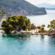 Islet of Virgin Mary, Parga, GreeceThis charming little islet, just across from the port of Parga has a little church and a small fortress built by the French in the 18th century when they controlled the port. Swim or pedal boat up to its lovely beach from Parga, a resort town in northwestern Greece.Photo: Shutterstock