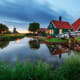 Zaandam, The NetherlandsZaandam is the classic image of the Netherlands - a country of windmills, quaint villages, tulips and canals. It is about 30 minutes from Amsterdam. There are several villages in the area, the most interesting and authentic ones are Zaandijk and Zaandam.Photo: Shutterstock