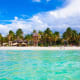9. Playa NorteIsla Mujeres, MexicoA popular vacation spot, Isla Mujeres is an island just off the coast of Cancun, Mexico. Playa Norte is considered on of the best beaches in all of Mexico. It has soft white sand, palm trees and water so blue it makes the sky look pale.Photo: Shutterstock