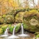 Mullerthal Region, LuxembourgLuxembourg's Little Switzerland, the Mullerthal region is a hilly landscape of unique rock formations popular among hikers for its trails that wander through fields and forests. The area has charming small villages and the ruins of castles, too. Pictured is Schiessentumpel Waterfall.Photo: Shutterstock