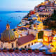 Positano, ItalyThis charming cliffside village on Italy's Amalfi Coast is a popular vacation destination with steep, narrow streets and a pebbley beach. Its centerpiece is the beautiful 13th-century Chiesa di Santa Maria Assunta with its majolica-tiled dome.Photo: Shutterstock