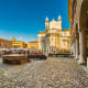 Modena'shistoric center packs a cultural punch with its monuments, museums, art, and entertainment.The university draws young people from around Italy to study law, medicine, and mechanical engineering. Pictured here arestalls of an antique market in the main square.Photo: Shutterstock
