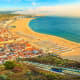 Nazare, PortugalNazare, a fairly small town of about 15,000, sitsonPortugal's coast between Lisbon and Porto. The climate is temperate, with highs reaching toward 85 F. in summer, dipping to around 50 F. in January.It might not suit those who are looking for year-round sun, but even in November rainfall averages only 3.5 inches.Photo: Shutterstock