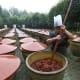 Above, a man stirschilibean sauce at the Sichuan Cuisine Museum in Chengdu.Photo: Pradit.Ph / Shutterstock