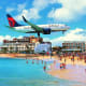 17. Delta Air LinesOverall score: 7.65 /10On-time performance score: 8.0Service quality score: 7.7Claim processing score: 7.2Above, a Delta Air Lines plane flies over Maho beach in Sint Maarten in the Caribbean.Photo: Gem Russan / Shutterstock