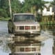 26. Davie, Fla. Total housing value at risk: $6.06 billionShare of housing in risk zone: 64%Number of homes in risk zone: 17,995Davie is also in Broward County. Above, a truck drives through flooded waters after a hurricane in 1999.Photo: Greg Mathieson/ FEMA