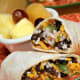 Qdoba has over 500 locations and plans to open 55 to 65 new restaurants this year. Todd Owen, Qdoba Mexican Grill's VP of Franchise Development, credits their unique strategy of partnering with high-level, multi-unit entrepreneurs for the boost in business—but we think it may have more to do with the fact that burritos are delicious, and affordable.More consumers are bound to look for lower cost meals due to the economic downturn. Expensive steakhouses are out; cheap Mexican food is in.