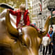 """Finally, I feel obliged to mention the famous statue of a charging bull near Wall Street in Manhattan. As someone who has lived in New York City for several years and worked around Wall Street, I have been approached many times by tourists desperately trying to find the bull so they can… I don't know, climb onto it and then have a picture taken of themselves pretending to ride it? I'll admit, it's a nice sculpture, and it has some nice symbolism being so close to the stock exchange, but ultimately, it's just a statue of a bull. Go find the real thing elsewhere. Like Pamplona. It's not worth fighting the crowds to get to this one. Photo Credit: Wagner T. Cassimiro """"Aranha"""""""