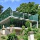 This London house overlooks the Victorian-era Highgate Cemetery. Philosopher andeconomistKarl Marx and punk impresario Malcolm McLaren are just two of the famous figures buried in the backyard. The windows are almost entirely frameless on the cemetery side, while the street side is a curtain wall of honed black granite, steel panels and opaque glass (for privacy). The house is listed for $7,974,450. Photo Credit: The Modern House