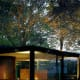 """A modernist statement – aka the use of industrial materialssuch asglass and steel for domestic home construction – was made by such visionary architectsas Mies van der Rohe, with his 1929 Barcelona Pavilion. Later he did the same in America with his """"Farnsworth House,"""" and Phillip Johnson followed suit with his """"Glass House"""" in New Canaan, Conn. These homes blur the line between indoor and outdoor spaces, and are studies in transparency and reflection. The proverb about """"people in glass houses"""" predates the building of the first glass home, but it certainly is good advice for anyone looking to live in one. Glass homes continue to make statements in residential design, though it does take a certain kind of person to feel comfortable with all that exposure. Life in a modernist fishbowl requires either a lot of chutzpah or plenty of private acreage. Not to mention some tight security to keep those gawkers away. For now, take a look at the best see-through homes on the market. Photo Credit: x-ray delta one"""