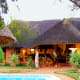 The lodge was built in 1960 and renovated in 2004while in operation as a luxury resortoffering gourmet dining and safari adventures. It has four suites and two family suites, each with a bathroom. There are also a common living room, bar, dining room and kitchen. For information contact La Farrell (+45-3033-9007) or visit the online listing. Photo Credit: La Farrell