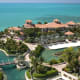 This total villa complex on Emerald Cay is connected to the Turks and Caicos mainland by a remote-controlled bridgefrom a 2.32-acre island that is on the market for $48,500,000. Yup, that's $48 million. Some of the amenities on the island are a home theater,three-story library,6,000-bottle wine cellar, two adjoining swimming pools with a waterfall and tennis and volleyball courts. The living areas are designed in an opulent Tuscan style with soaring columns, 24-foot cypress ceilings and massive glass doors. Photo Credit: Private Islands Inc