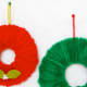 Materials: Pipe cleaners, a donut-shaped piece of Styrofoam, felt, plastic berries, glue gun; all can all be purchased at your local craft store. Instructions: Wrap the foam with the pipe cleaners, twisting them in the back to secure them. Separately, cut felt in the shape of leaves and attach berries to them with the glue gun. Once the glue on the berries and felt leaves is dry, use the glue gun to attach the leaves to the wreath. Hang with string or yarn and voila! Photo Credit: