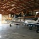 The humongous hangar measures 5,400 sq. ft. with room for 3 or more airplanes. The hanger space, tall enough in which to play basketball, has a full bathroom, a 900 sq. ft. workshop with climate control, pilot's lounge and direct access to the living quarters. Photo Credit: Joe Roberts, owner