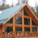 Up in the land of glaciers and Sarah Palin, in the rugged Alaskan outpost of Wasilla, an approx. 1,800 sq. ft. lake front log home listed at $550,000 offers 3 bedrooms, 2 bathrooms and a wall of windows in the main living space with unobstructed views of Meadow Lake and the surrounding, heavily wooded mountains. Photo Credit: Dar Walden / Keller Williams Realty-Alaska Group