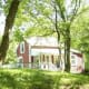 In the beautiful Blue Ridge Mountains outside of Round Hill, Va., a tiny This Old House-style cottage is currently listed at $199,999. The one-bedroom and one-bathroom house was built in the 1880s, measures approximately 500 square feet and sits on more than three acres ensuring privacy and preserved views of the surrounding woods. Photo Credit: Vicki Broy / Top of VA