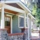In the trendy neighborhood of Mount Washington, just north of downtown Los Angeles and minutes from Pasadena, a bantam 430 square-foot bungalow with one bedroom and one bathroom is currently listed with an asking price of $402,000. The Craftsman style bungalow sits on a wee .12 acre lot, has classic clapboard siding and river rock accents on the exterior, a small front porch with a glittery city view, hardwood floors and a galley kitchen with tile counter tops and an adjacent pantry/service porch for extra storage, always a good thing in a house about the size of a two-car garage. Photo Credit: Mark Meinhardt / Keller & Associates Realty