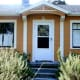 A picayune pad in Portland, Ore., is just 560 square feet and listed for sale with an asking price of $189,000. The home has two bedrooms, one bathroom, a vintage kitchen with new bamboo floors and a living room with a wood-burning fireplace. The freshly painted house also has a 280 square-foot basement for storage and services. The yard is planted with a mature organic garden, multiple fruit trees (apples, pears, peaches) and there's even a chicken coop in the backyard. Photo Credit: Portland's Alternative Realtors