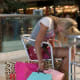 """Shopping addiction can come about for a variety of reasons, says Shulman. """"We all have money issues to varying degrees,"""" he says, """"but typically something traumatic happens and then they start."""" Shulman lists several triggers, from an unhappy marriage to losing one's income to having unwanted children. Often, he says, these addicts turn to shopping because it's """"the only thing they can control in their life. For the shopaholic, they distract themselves for a moment, they zero in on something and find something, and for a moment, everything is blacked out. All they're thinking about is getting what they want. And when they get it, they feel an accomplishment."""" To identify the root of one's problem most people need specialized help, says Shulman. """"With shopping addiction, sex addiction, and eating addiction, the goal is never complete abstinence, but it's to figure out what's driving compulsive eating disorder, sexual disorder and shopping addiction."""" Photo Credit: Getty Images"""