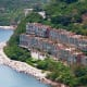 Repulse Bay, one of Hong Kong's most desirable and expensive suburbs, sits on the scenic southern side of Hong Kong Island, where a large, but far from huge apartment sits perched on a cliff with fetching views of the bay and beach. The apartment carries an asking price of $16 million (HKD 122 million). Photo Credit: Sotheby's International Realty