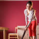"While it's a good idea to straighten up before your guests come over, you don't need to break out the heavy cleaning artillery until after they've gone for the evening. ""I rarely vacuum [before a party],"" Rabideau says. ""You would only have to do it again once the party is over."" Photo Credit: Getty Images"