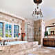 The master suite has an oversized balcony and an en-suite marble tub. The Gunvalsons have had the home on and off the market numerous times since 2007. But unlike in 2007, the Gunvalsons are not listing with former castmate and neighbor Jeana Keough (who almost foreclosed on her home own just across the street). Photo Credit: Laura Simmons/Weichert-Gold Coast