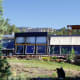 Built in 1998 on 4.5 acres in Colorado's western slope is a totally OTG home with backup systems for heat, water and power that's on the market for $495,000. The unique home is an example of an Earthship – a type of passive solar home made out of old tires filled with dirt and recycled aluminum cans to create dense thermal mass walls that store heat and slowly release energy. The home is just three miles from the famous 8,500-square-foot Earthship mansion owned by former actor and environmentalist Dennis Weaver. The entire front of the house is glass and metal trim to allow for minimum maintenance, maximum view and solar gain. The total efficiency of the passive solar design eliminates the need for most heating or cooling year-round. Photo Credit: Bob and Karen LeCour