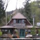 """This two-story cottage-style floating home built in 1989 is situated about 10 miles northwest of downtown Portland. From the home, you can view down the river and over to Sauvie Island and the island bridge. It includes not only """"slip ownership,"""" but also a 1/12th share of the entire 29 home moorage and is listed for $285,000. Photo Credit: Graham Marden"""