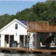 On this lake created by the Norris Dam back in the 1930s, a floating cottage and dock is on sale for $59,000. It's a modest 480-sq. foot living space with one finished bedroom and an unfinished attic that would make a nice vacation getaway. Rumor around the lake is that there are catfish the size of small cars lurking around the deep waters of the Norris Dam. For more information and pricing information contact Travis Keller (865) 293-8258 or visit the website. View the online listing here Photo Credit: Travis Keller