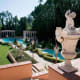 A garden level contains an art-deco nightclub, wine cellar and one of two projection rooms in the residence. Another level contains spa facilities with a gym and massage room. Also notable is the original landscaping by Paul Thiene, classical statuary and cascading waterfalls that flow into one of the pools flanked by Venetian columns. Photo Credit: Hilton & Hyland