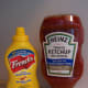 """Ketchup, mustard and other vinegar-based condiments are able to survive warm environments for the same reason that hot sauce doesn't need to be in the fridge: The high acidity of these foods makes them poor breeding grounds for bacteria. The USDA also lists pickles as being OK at room temperature for much the same reason. """"The pH of ketchup is around 3.6, which is acidic enough to avoid needing to refrigerate it,"""" says Potter. """"Likewise, as long as the mustard is of low enough pH (less than 4.0, according to the FDA), then there's no need to refrigerate it, although a number of mustard manufacturers recommend keeping their product refrigerated to help maintain flavor."""" Basically, if you're having a barbecue, it's OK if the burger toppings sit outside all afternoon. The exception is mayonnaise (if you're a mayo-on-your-burger type). The USDA says that mayonnaise, tartar sauce and horseradish should be discarded if they spend more than eight hours above 50 degrees Fahrenheit. Photo Credit: WindyWinters"""