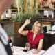 "Everyone knows it can be frustrating to try to get your waiter's attention during a busy dinner shift, but there's a right way and a wrong way to flag down your server. ""Raise your hand or make eye contact; don't snap [your fingers] and don't wave,"" says Dublanica. And don't even think about physically grabbing a waiter as they walk by, especially if they're carrying something. If it's a special night and you want truly exceptional service, he says you can try slipping your server some cash at the beginning of the meal and requesting special attention. But there's generally one surefire way to ensure the server keeps coming back to your table, and it doesn't require you to pay out a bribe. ""The best thing is to be polite, be nice, and say 'please' and 'thank you',"" he says. Photo Credit: Getty Images"