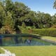 Several of the manmade and natural ponds sitting on the 350 acres of farmland property look a lot like swimming pools. Why not take a dip? Photo Credit: Heather Croner Real Estate Sotheby's International Realty
