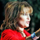 """As governor of Alaska, Sarah Palin earned $125,000 a year. Since resigning midterm in 2009, the """"mama grizzly"""" has boosted her bank account by millions. Some media estimates, including one often-cited stab at a tally by ABC News, was that Palin earned close to $12 million in speaking engagements and TV and book deals during her first year out of office. That accounting was later challenged by Forbes as overstating the income from her first book, the best-selling Going Rogue, published by HarperCollins. ABC claimed to have sources that put the paycheck near $7 million; Forbes says the amount was probably closer to $2.5 million. In support of the second estimate is that Palin was forced to report $1.25 million she got as the first of two payments for her book deal, since the check was cashed while she was still in office. The book went on to sell more than 2 million copies and was followed by America by Heart. Book money aside, Palin earned roughly $250,000 an episode for her now-canceled reality series about Alaska on the Learning Channel. She's also made big money on the speaking circuit, charging about $100,000 for every paid speech. The financial terms of Palin's multiyear contract with Fox News (Stock Quote: NWS) as a correspondent have not been disclosed. Photo Credit: AP"""