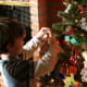 """If you have little money, or none at all, """"decouple the concept of Christmas with materialism,"""" says McCall. Instead, spend quality time with your family. For many families, that means decorating the Christmas tree, playing games and going to see neighborhood Christmas lights, McCall says. McCall herself says her family likes to build graham cracker houses as an evening event together. If there aren't going to be gifts under the tree Christmas morning, make sure you have other plans. If you have older kids, you could go to a soup kitchen to help spread the spirit of Christmas as a family, she adds. You can get together with other families and or go play in the snow together. Some families even write, practice and perform their own Christmas play for the family. And all the preparation takes focus off of the gifts, McCall notes. Photo Credit: John-Morgan"""