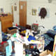 "This picture, uploaded by Tobo, has the title ""Our Very Messy Room."" Now this is clearly a dorm room, and given the title, one would assume it's a double, which means that there should be two twin beds in there. I see only one. That means that somewhere, buried underneath all that stuff, is an entire bed. Photo Credit: tobo"