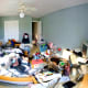 "Boltron's Flickr profile says he likes ""pretty pictures and rap."" If this is indeed his room, he also evidently loves huge piles of stuff on his bed, random bins full of more stuff and walls free of any stuff – pretty pictures or otherwise. Photo Credit: Boltron"