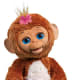 """Ages 4 years & up Approx. Retail Price: $79.99 Requires 4 C batteries, not included From Hasbro's line of Furreal Friends comes Cuddles My Giggly Monkey, which is lifelike and engaging. It has more than 100 responses ranging from silly to sweet and offers a range of interactive emotions. When it wakes up, Cuddles My Giggly Monkey opens its eyes and makes sweet noises. Snuggle up to it and it will lean and cuddle to you closely. Feed it from the banana-shaped bottle and it will make slurping noises, moving its lips in and out. Swing the baby monkey and it will laugh and make silly sounds. Tickle its tummy, and it will burst into a fit of giggles. Rock it to sleep, and it will snooze and gently close its eyes. When you're not playing with it, your """"pet"""" will move its head and make sounds to grab your attention. Cuddles My Giggly Monkey comes with a bottle, pink bow and removable diaper."""