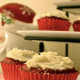 You spent hours making those sweet treats, might as well get the most out of them. For Christmas, I like to make red velvet cupcakes with cream cheese frosting. They look good on a cupcake stand, but in this case, I used what I had on hand -- a three-tiered appetizer stand. Set them next to favor boxes for guests to enjoy after your dinner party.