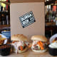 """The newly launched national burger delivery service finds its roots in the quirky and humorous Boston Burger Co., which is known for their creative burgers such as the """"Artery Clogger"""" and """"Mac Attack,"""" a homemade four-cheese mac & cheese, bacon burger that was featured on Food Network's """"Diner's, Drive-Ins, and Dives"""" with Guy Fieri.""""People are already coming into our restaurant and we knew that people liked what we did in the restaurant,"""" said Chuck Sillari, founder and co-owner of Boston Burger and BurgaBox. """"Imagine if they've got the ingredients and they can get them shipped to their home to make all the crazy burgers that we do in the restaurant.""""BurgaBox came about when Chuck Sillari, Paul Malvone, and Sebastian Fricia, the three founders and owners of Boston Burger Co. saw what's inside a HelloFresh box that was delivered to one of their employees in the office one day. """"I really couldn't believe that people were getting groceries shipped to their houses by FedEx to avoid going to the supermarket,"""" said Sillari, who instead came up with the idea to give people the option of """"a cheat day in a box"""" instead of """"a skimpy health conscious meal.""""The Boston-based food startup now ships about 200 boxes nationwide per month. The packaged $15 per meal burger box is a favorite among people who went to college in Boston and have since moved to other states."""