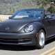 """Starting price: $25,490Miles per gallon: 25 city, 34 highway, 29.5 combinedThe Beetle traces its roots back to World War II, but, by the mid-1970s, other compact cars began encroaching on the Beetle's turf and Volkswagen was staring down bankruptcy. To right the ship, Volkswagen had to ditch the Beetle in favor of the Golf hatchback.Thus began the more than 20-year absence of new Beetles from U.S. roads. By the time a New Beetle concept car surfaced in 1994, engineers had figured out how to put the engine up front, how to give it front wheel drive and a more spacious interior and make it look like an updated version of the original while giving it little tweaks like a flower vase in the dashboard. The current Beetle's power soft top, 6.3-inch touchscreen apps display, rearview camera, blind spot monitor and 210-horsepower turbocharged engine don't get the reception that accompanied the Beetle's comeback and spawned the """"new futurism"""" of updated Mustangs and Camaros, but it's a sweet throwback of a ride nonetheless."""