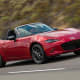 Starting price: $24,915Miles per gallon equivalent: 27 city, 36 highway, 31.5 combined What does a Miata owner have that a Porsche Boxster owner doesn't. Almost $30,000 extra dollars, a more reliable automobile and, maybe, just a little more self confidence. O.K., so the engine is is a little pokier at 155-horsepower from a 2-liter, 4-cylinder -- no matter which trim you pay for. That said, the two cars have similar acceleration (zero to 60 in 6.5 seconds for the Porsche, seven seconds for the Miata), similar ratings from Consumer Reports (90 for Porsche, 89 for Mazda) and similar customer satisfaction. The Miata's available hardtop that kicks the starting price up above $27,000 only closes the gap further.Redesigned this year with lower ground clearance than ever and with musclebound, stingray-style curves, the Miata is also 148 pounds lighter. That's great for its mileage and for the addition of perks like a Mazda Connect touchscreen and communications system, but it also makes that engine feel a lot zippier, if not exactly Porsche fast.