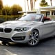 """Starting price: $38,650Miles per gallon: 23 city, 34 highway, 28.5 mpgIf the 3 Series is the """"entry level"""" BMW, the 2 Series is the discount BMW: The """"What's he doing in a BMW?"""" Beemer.With a bit more plastic in the interior, a bit more petrochemical upholstery on the sheets and just a 2.0-liter 4-cylinder, 240-horsepower turbo engine under the hood, it's basically a baby step above the company's Mini badge. However, with its sport setting, stability control and performance suspension, this soft-top bargain BMW wants to give you all the fun of driving this brand at the cost of some of its more luxurious components. You still get the iDrive touchscreen computer system, rain-sensing wipers, automatic climate control and keyless ignition, but the satellite radio is extra, leather and wood are nonexistent and the more high-tech safety features are noticeably absent. That said, you're in a BMW convertible for less than $40,000: just hope nobody at the club realizes which one."""