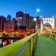 Pittsburgh was ranked SmartAsset's second best city for new graduates. The city scored well across the board, receiving a score of 62.72 for job availability, a score of 78.20 for affordability and a score of 91.57 for life outside of work.The median gross rent (rent plus utilities and fuel expenses) in Pittsburgh was $794 for the four years through 2014, while the average travel time to work is approximately 23 minutes, according to the U.S. Census Bureau.That said, the unemployment rate for Pittsburgh area was 5.9% as of March 2016, higher than the national average, according to the BLS. (Though SmartAsset points out that the unemployment rate for those with at least a bachelor's degree drops to just 2.7%.)Large companies that credit Pittsburgh as their hometown include U.S. Steel, PNC Financial Services, PPG Industries, WESCO International, Allegheny Technologies, American Eagle Outfitters and GNC.The city is also home to several major universities and colleges, including Carnegie Mellon, University of Pittsburgh and Duquesne.