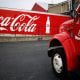 """Coca-Cola is a global beverage company that sells soft drinks, fruit juices, sports drinks and other beverages. The $189-billion market cap company is based in Atlanta.Earlier in February, the beverage maker posted better-than-expected profit and revenue for its fourth quarter. Coca-Cola's cost cutting measures helped it navigate a challenging macro environment, according to Forbes.""""Coca-Cola has improved its marketing and changed its cost structure while perennially boosting its dividend. I think it's going to do quite well in a deflationary environment,"""" Cramer wrote.Coca-Cola shares have risen approximately 0.5%this year, compared withthe S&P 500, which has fallen 4.7%."""