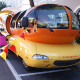Between 1953 and 2004, there would be seven more designs of the Wienermobile. In 1958,Brooks Stevens, who did the redesign of the 1962 Stubeacker Corp.'s Gran Turismo Hawks as well as some Harley-Davidson Inc. motorcycles, gave the vehicle its signature look by putting a 27-foot-long frank on a bun and giving it a bubble-head cockpit.In 2004, the Wienermobile got a voice-activated GPS as well as an audio center and a wireless microphone. It was also furnished with a new horn, and it played the Wiener Jingle in 21 different music genres, including Cajun, rap and Bossa Nova.